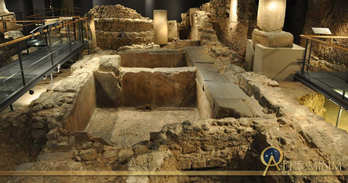 Remains of an ancient Roman salt fish factory and garum factory in the archaeological underground ruins at Plaça del Rei.