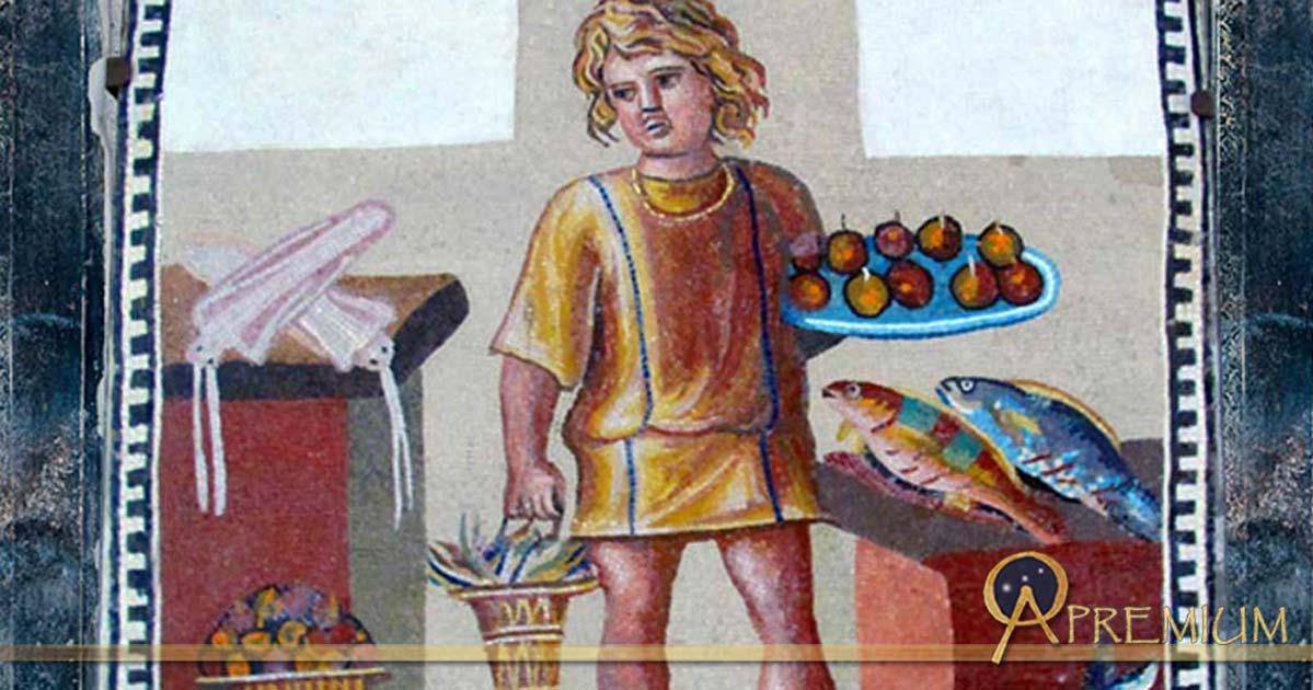 A boy holding a platter of fruits with a bucket of crabs, in a kitchen with fish and squid, on the June panel from a mosaic depicting the months (3rd century)