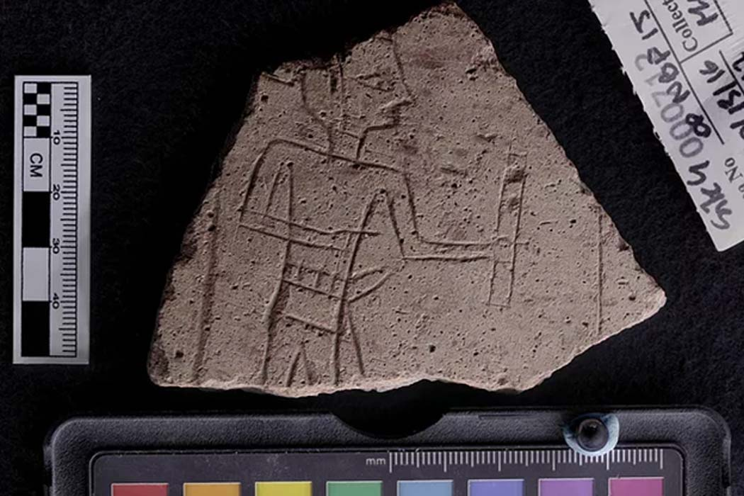 An etched pot sherd with an image of a scribe holding an ink palette. Found near an ancient Egyptian amethyst mine.