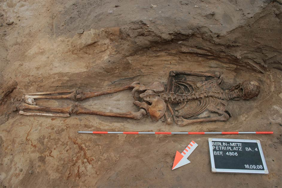 Photograph of a face-down burial, also known as a prone burial, in a churchyard in Berlin, just one of almost a hundred medieval and post-medieval burials in Switzerland, Germany, and Austria included in the study. Source: (Claudia Maria Melisch / Landesdenkmalamt Berlin)
