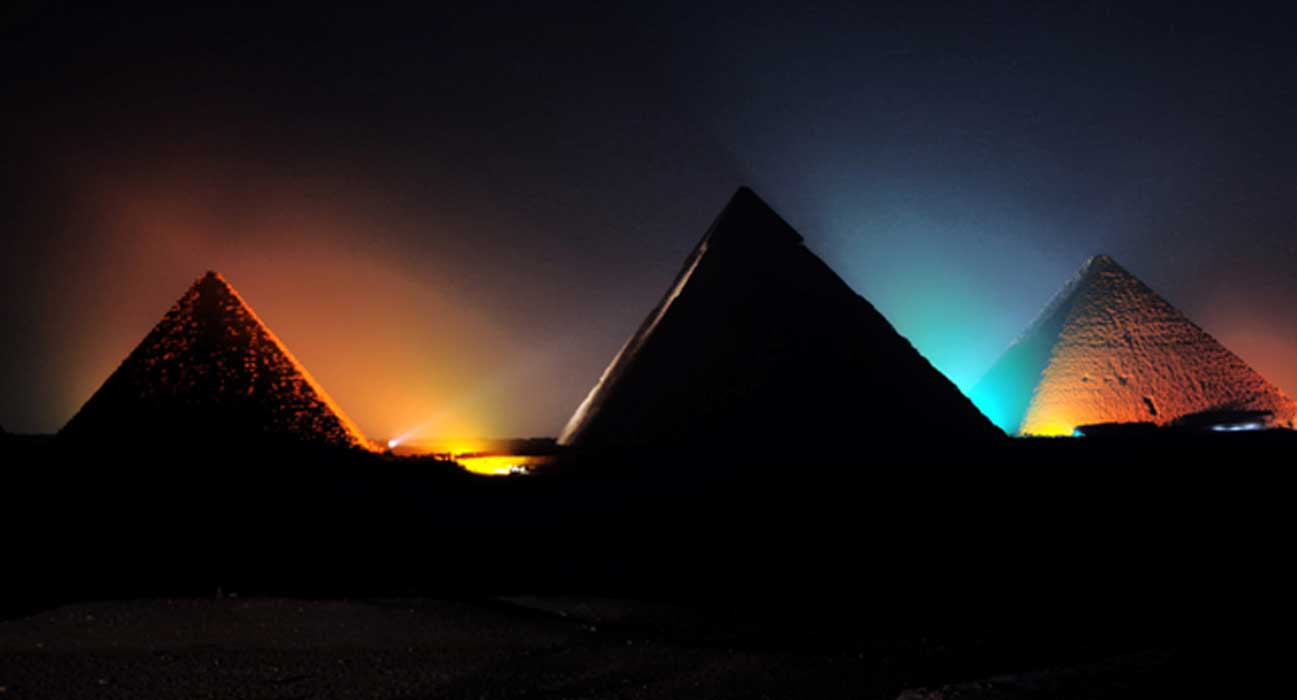 The pyramids of Giza at night.
