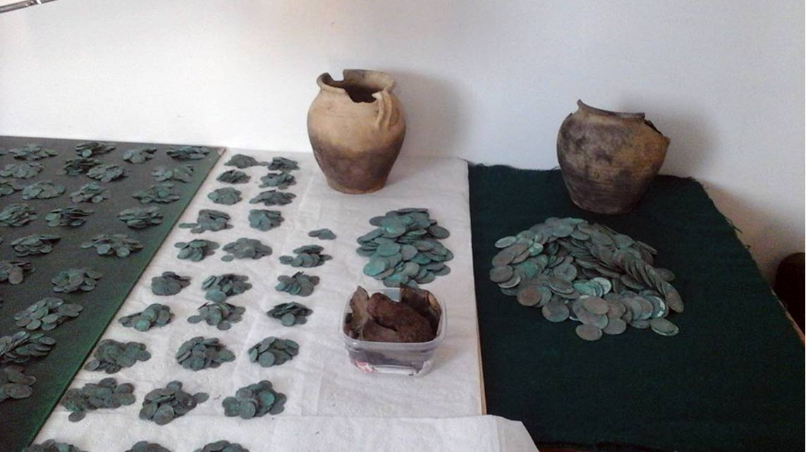 Hidden hoard of more than 6,000 silver coins found in forest in Poland