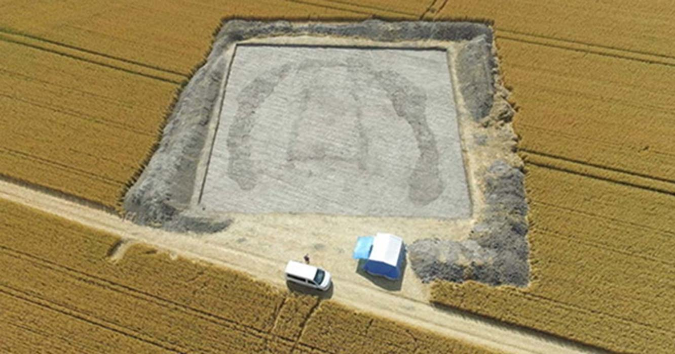 Top image: Archaeologists looking at aerial photography found what they thought to be a hidden long barrow, or Neolithic burial chamber, hidden beneath a wheat field.