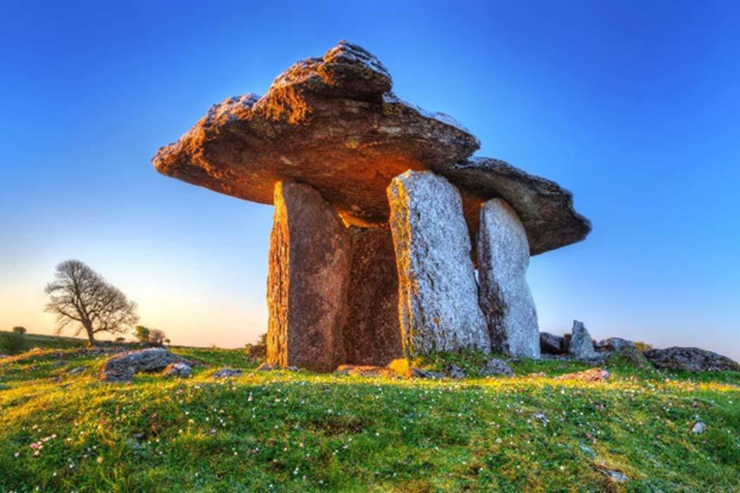 Poulnabrone portal tomb in Burren at sunrise, Ireland.