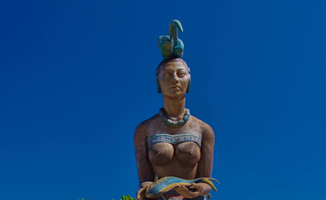 The Maya goddess Ix Chel wearing a coiled snake headdress