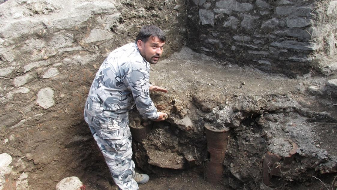 Archaeologist Ivan Hristov displays the Jacuzzi heater