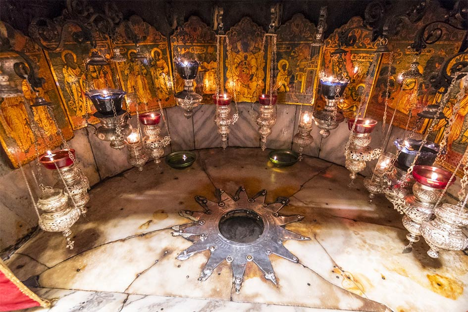 A silver star marks the traditional site Jesus' birthplace in a grotto underneath Bethlehem's Church of the Nativity.
