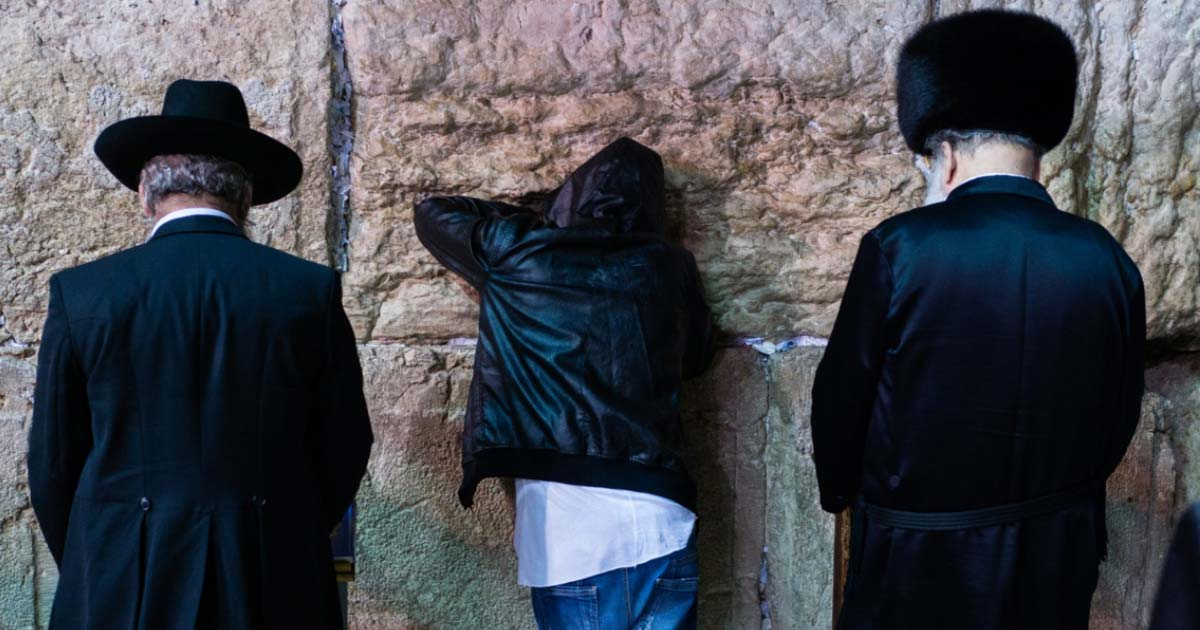 Three different Jewish people giving Selichot prayers at the Wailing Wall, Jerusalem