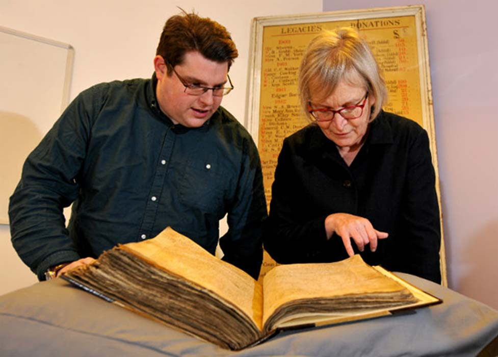 Gary Brannan and Sarah Rees Jones examine the note regarding Joan of Leeds in one of the archbishops' registers.