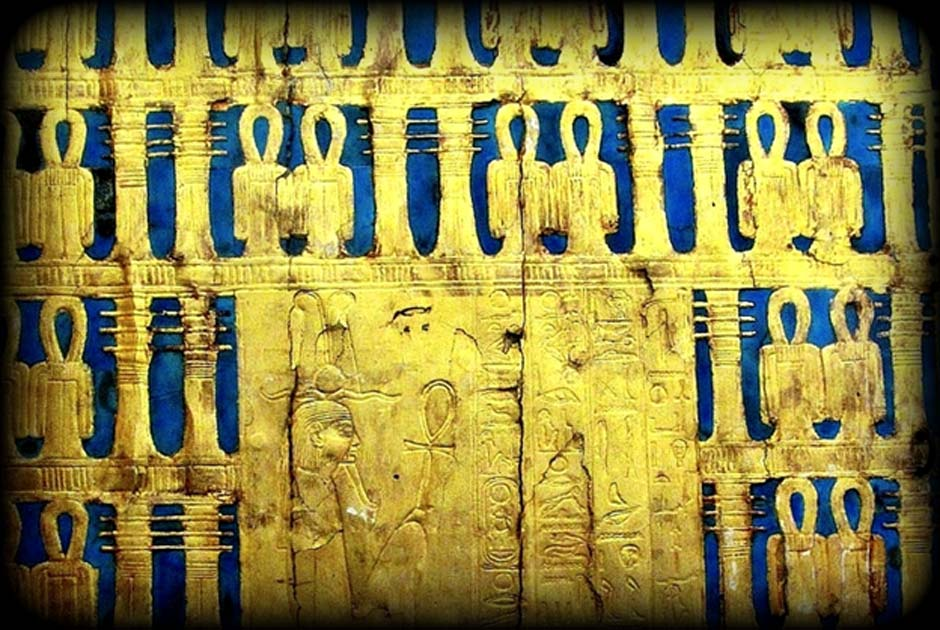 Detail from the outermost shrine of Tutankhamun showing a seated deity; design by Anand Balaji