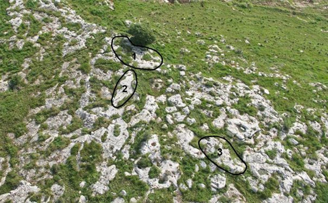 Aerial view of Kaizer Hilltop with three sampled rock surfaces marked in black circles