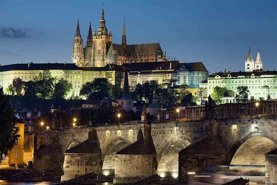 Night view of the castle and Charles Bridge, Prague, Czech Republic. Prague, over time, became the definitive center of the growing Kingdom of Bohemia.