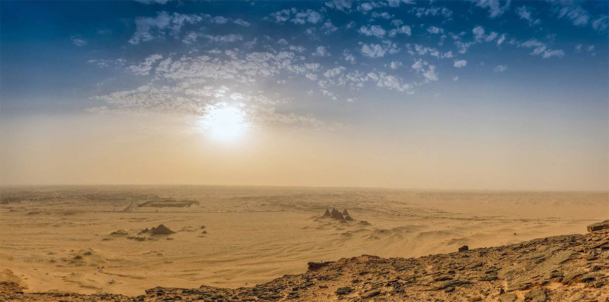 Archaeological site Jabal Maragha in Sudan has been destroyed by industrial-scale looting. Illustrative image from Jebel Bakal across the Sudanese desert with the pyramids. Source: Frank / Adobe Stock