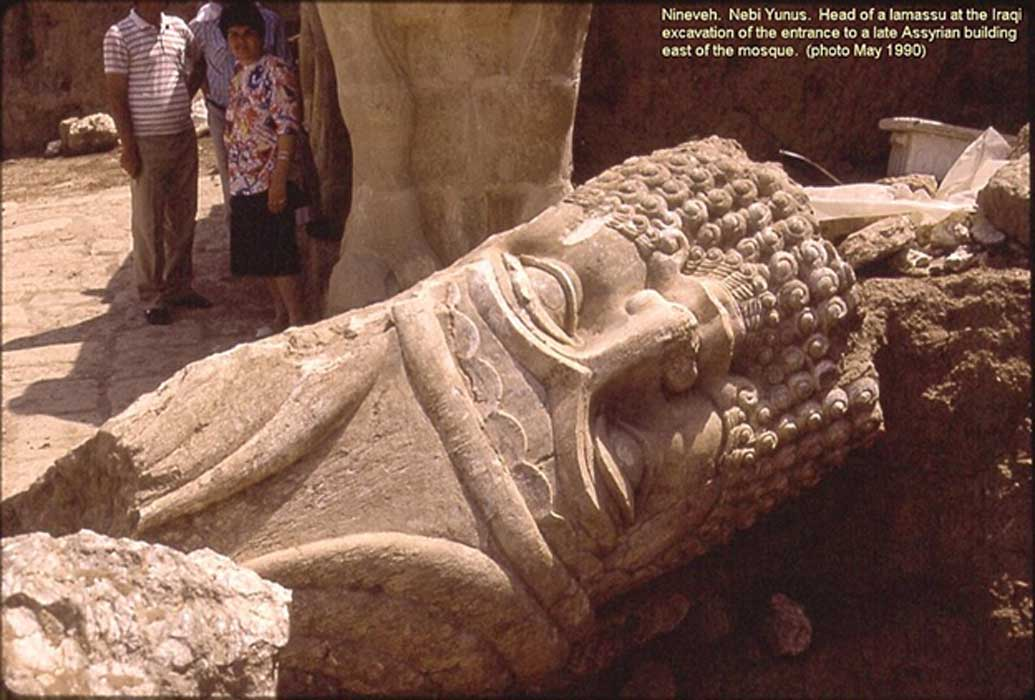 The now destroyed Nebi Yunus in Nineveh. Iraqi archaeologists excavate the monumental entrance to a late Assyrian building. The large head of a bull-man sculpture lies in a passageway.
