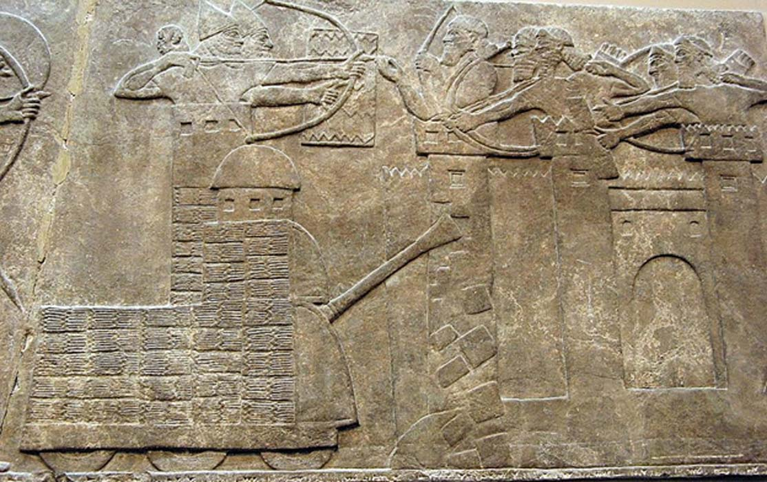 Assyrian attack on a town with archers and a wheeled battering ram, 865–860 BC.