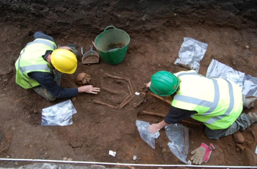 Archaeologists exhume a body from the quadrangle of Robert Gordon College in Aberdeen, Scotland.