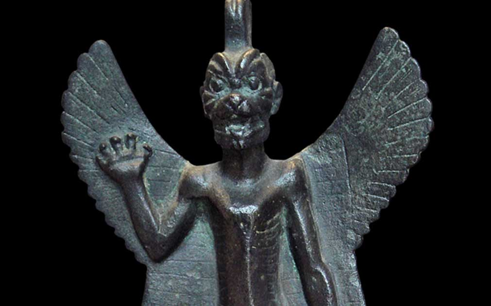 Detail of a bronze statuette of Pazuzu, circa 800 BC - circa 700 BC. Pazuzu was an Assyrian evil spirit believed to frighten away other evil spirits - protecting humans against plagues and misfortunes.