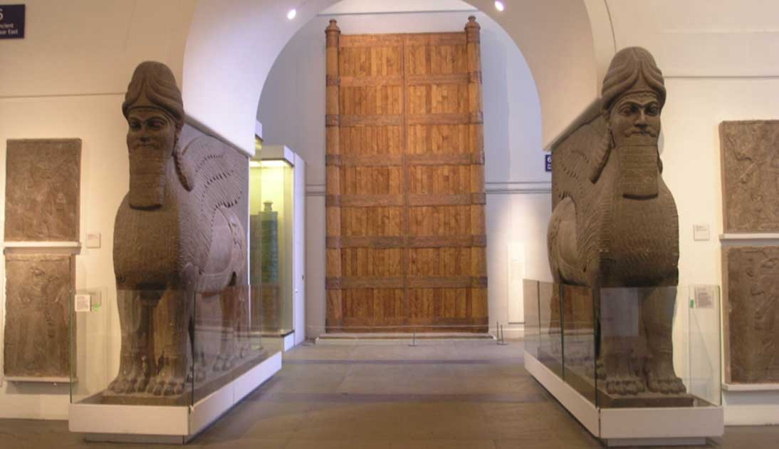 The British Museum - Room 6. Foreground: Assyrian Gateway Human Headed Winged Lions 'Lamassu' from the North West Palace of Ashurnasirpal II in Nimrud.
