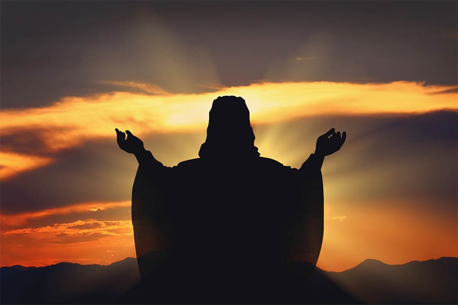 Silhouette Jesus in the sunset. Source: artphotoclub / Adobe Stock