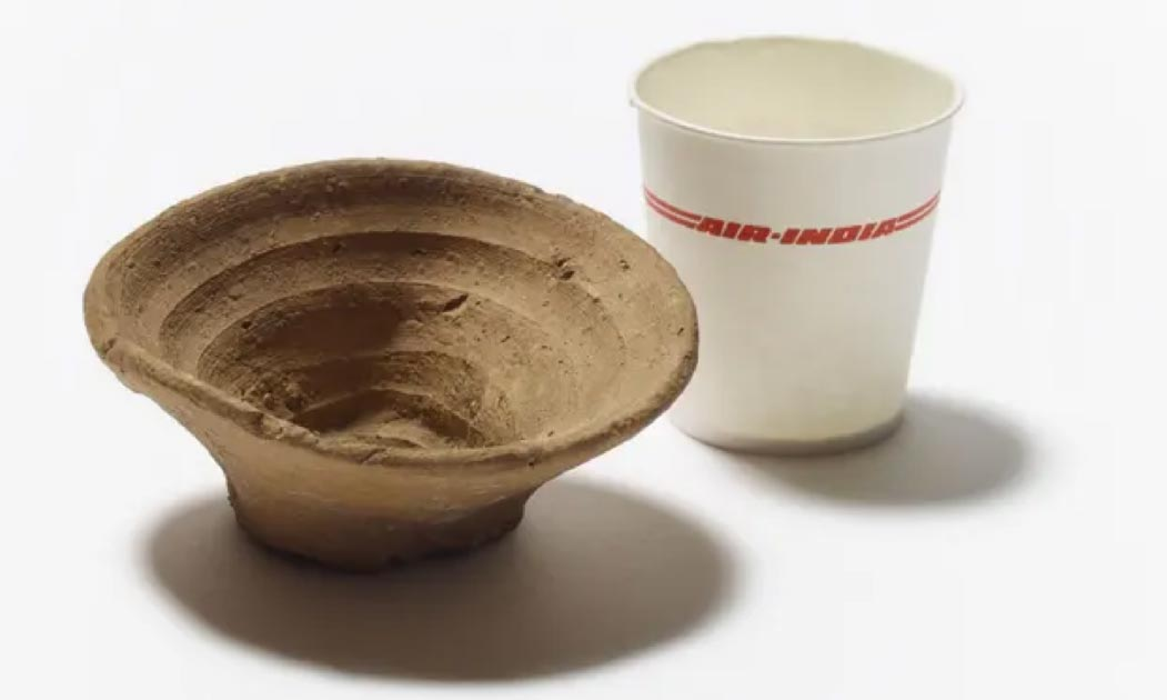 The Minoan cup, shown here next to a modern throwaway container that washed up in the Pacific.    Source: Trustees of the British Museum