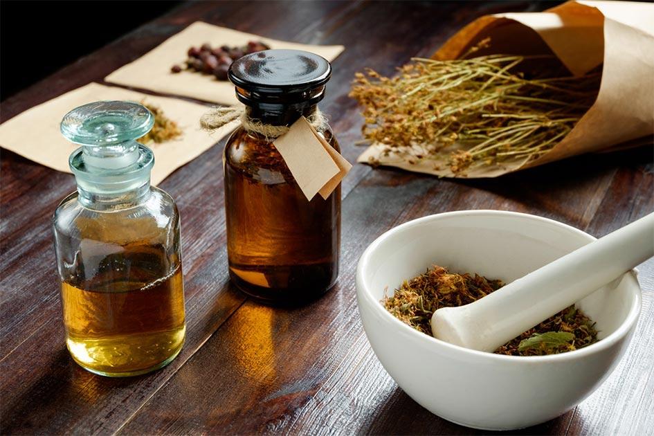 Apothecary vintage set of bottles, herbs and mortar Source: Kiryl Lis/ Adobe Stock