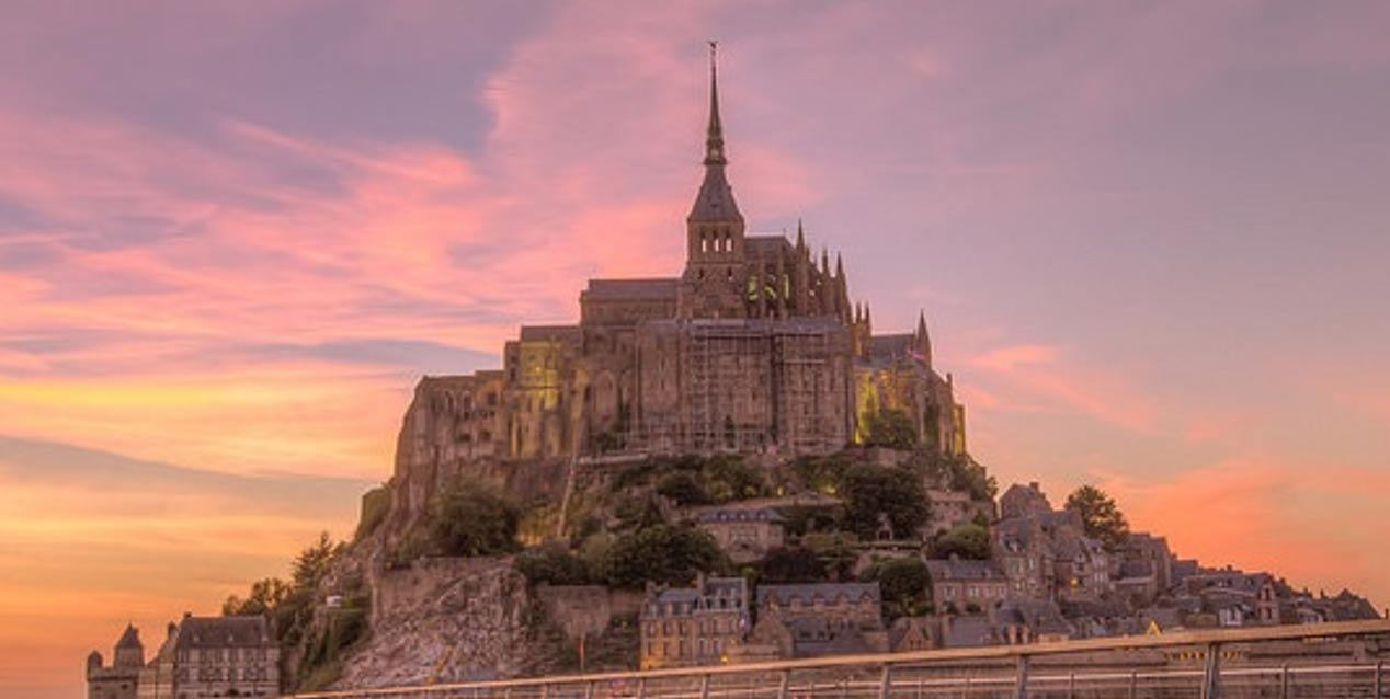 The iconic features of Mont Saint-Michel in the evening light.