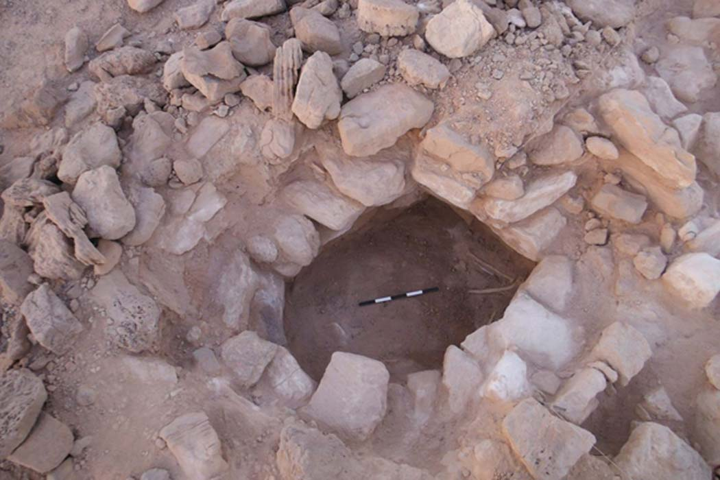 Stones cover the body of the first remains of a woman found at copper mines in Timna, Israel - and she was pregnant.