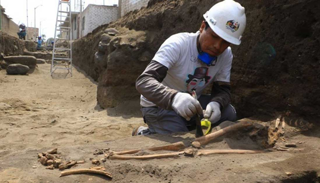 Excavating one of the Pre-Inca tombs.