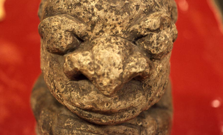 A close-up of a Nomoli figure taken in the British Museum