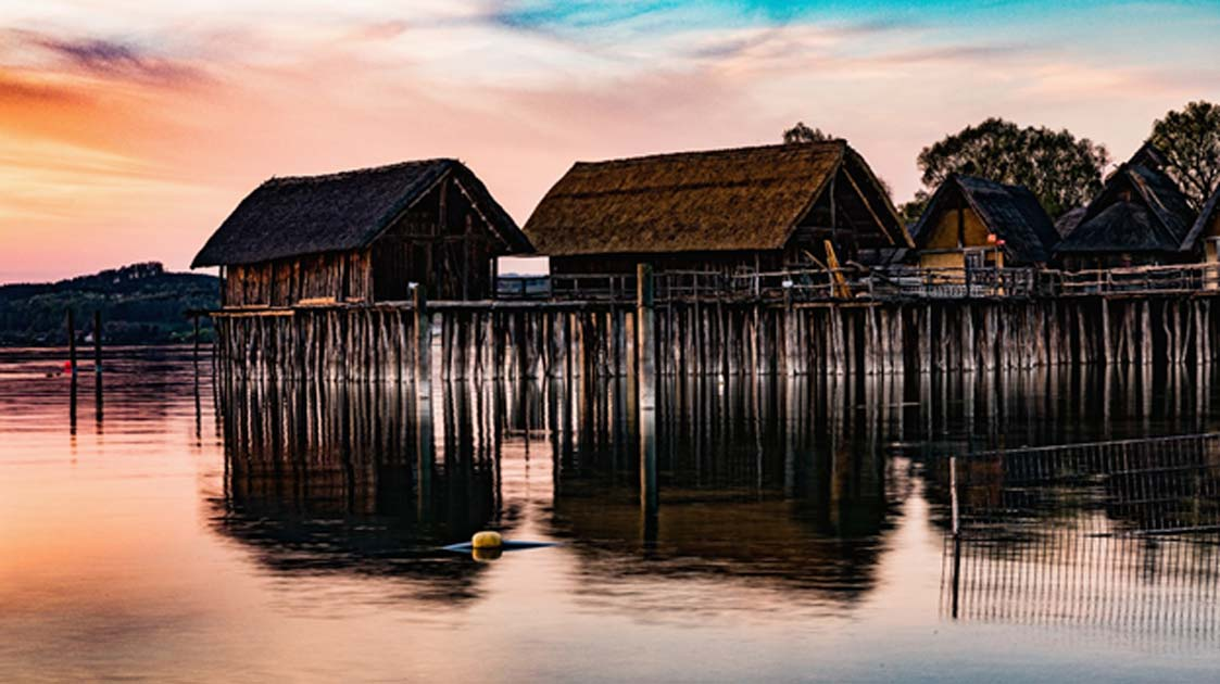 Colorful sunset at Lake Dwellings of the Stone and Bronze Age at Pfahlbaumuseum in Unteruhldingen on Lake Constance, Baden-Wurttemberg.