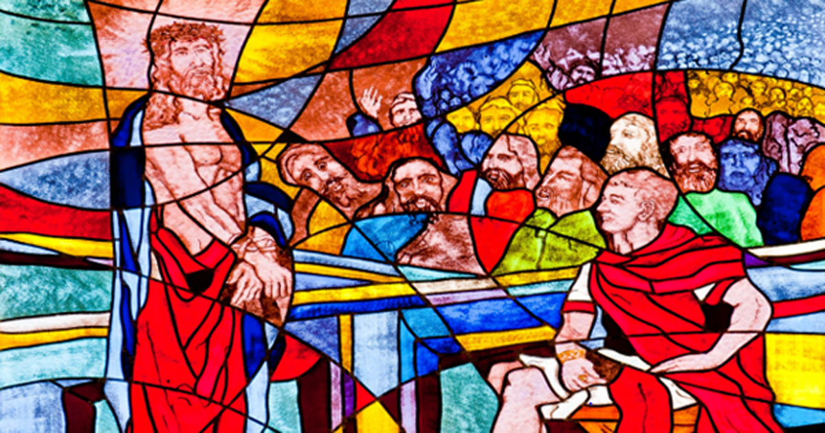 Stained glass image of Pontius Pilot condemning Jesus to death.