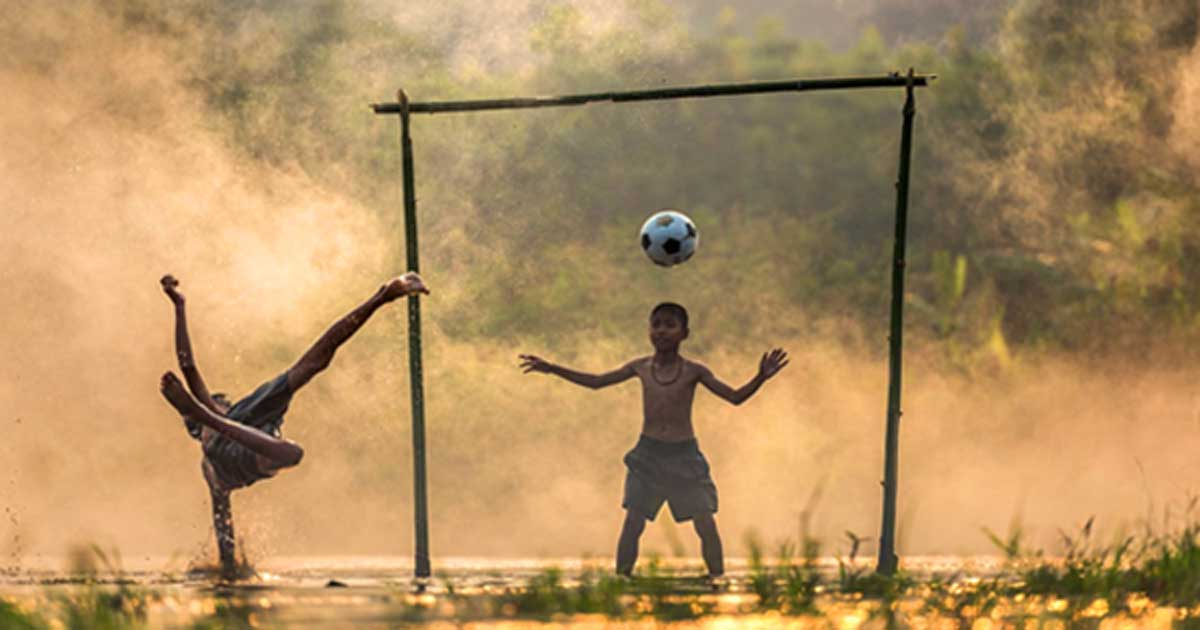 Children playing football in Thailand