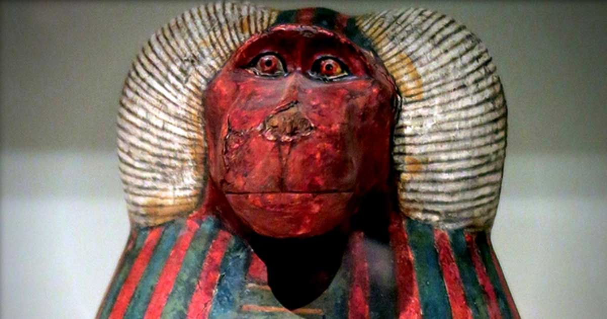 Detail from one of the canopic jars of Padiouf, a                    priest of Amun, shows the face of the god Hapy; design                    by Anand Balaj
