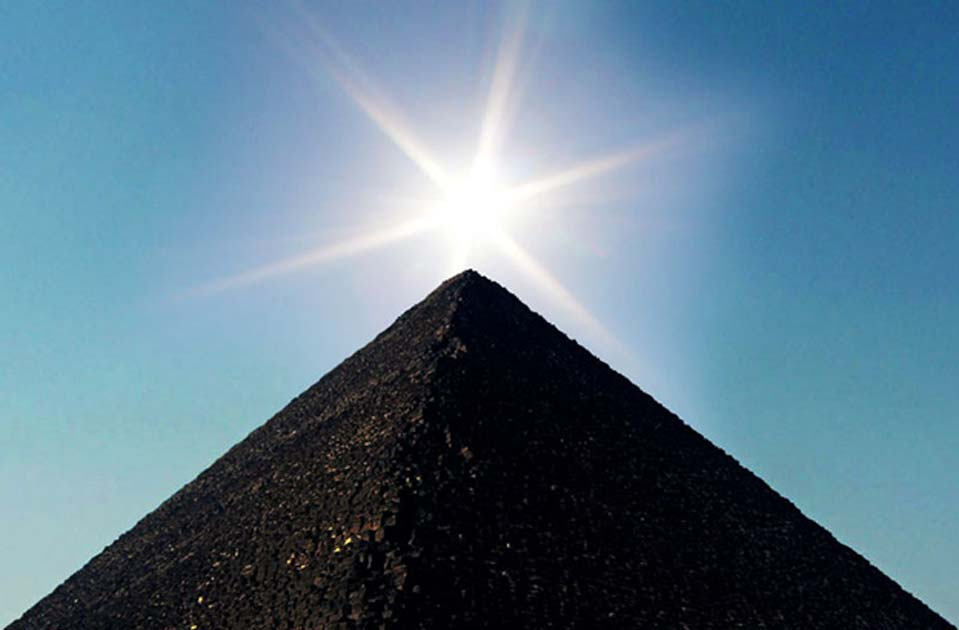 Great Pyramid of Giza in the rays of the sun.