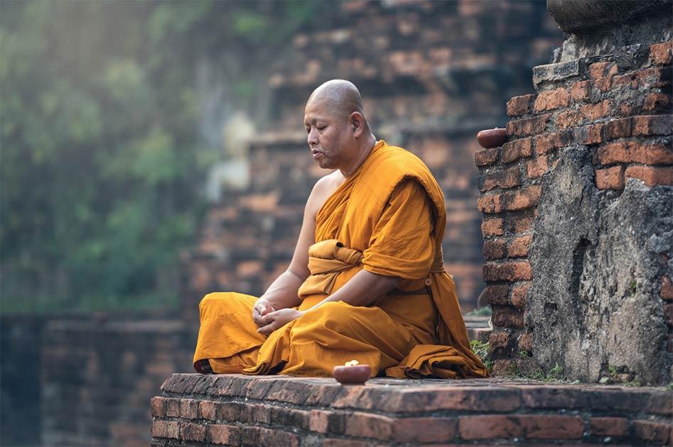 Buddhist monk meditation in temple             Source: Sasint / Adobe Stock