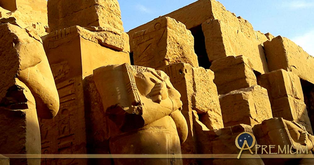 Enormous headless Osiride sculptures of Pharaoh Ramesses III stand in the colonnade of the king's Barque Chapel south of the second pylon at Karnak Temple; design by Anand Balaji (Photo credit: Anand Balaji); Deriv.