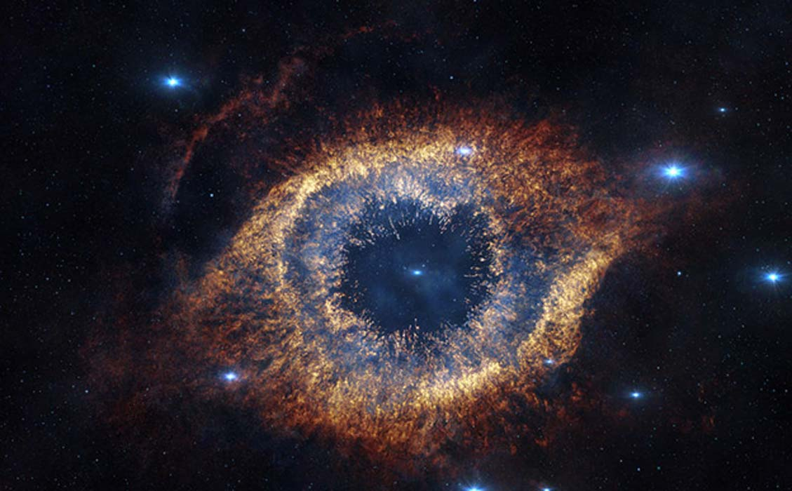 "ESO's Visible and Infrared Survey Telescope for Astronomy (VISTA) has captured this unusual view of the Helix Nebula (NGC 7293), a planetary nebula located 700 light-years away. The Helix Nebula is sometimes called the ""Eye of God."""