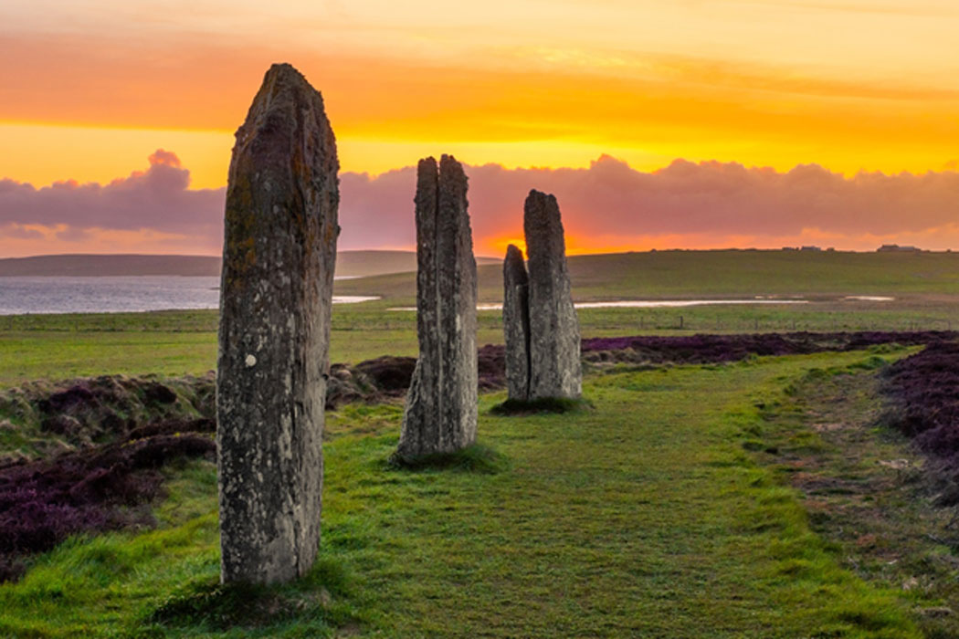 Three standing stones of the ancient and mysterious Ring of Brodgar (Oliver / Adobe Stock)