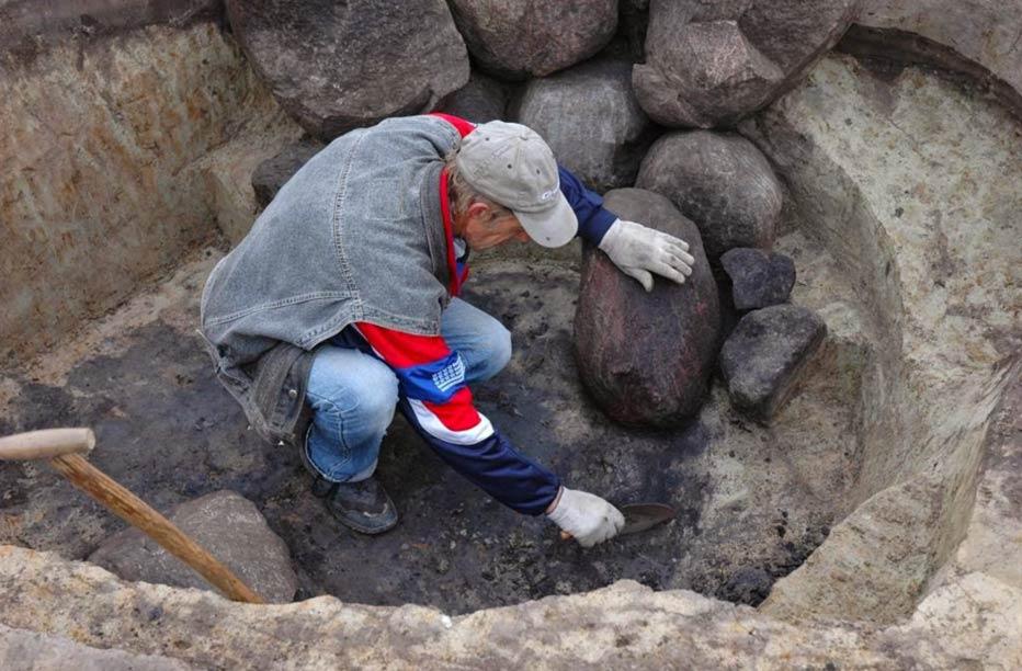 An archaeologist at work in a Roman-era necropolis in Poland