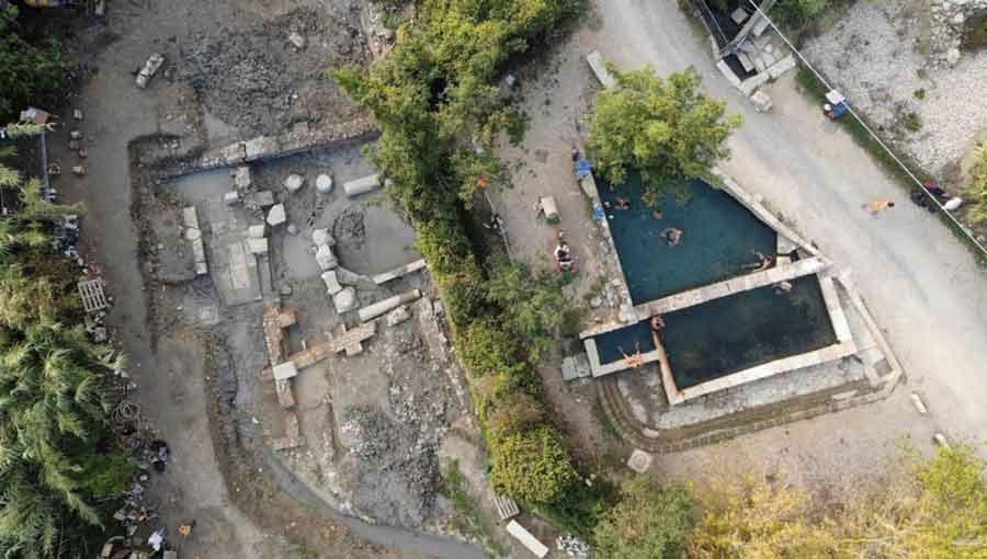The San Casciano dei Bagni ancient Roman bath site (left), next to the modern baths.