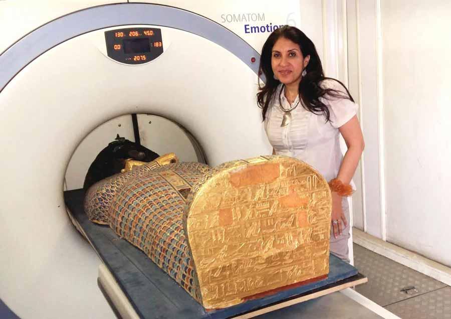 Dr Sahar Saleem placing the mummy of Seqenenre in the CT scanner.