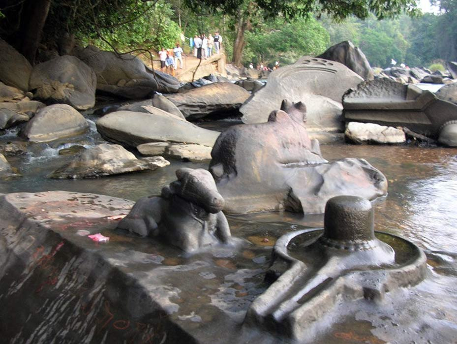 The riverbed rock carvings also show Nandi, Shiva's bull mount. The lingam in this photo is the protuberance, and the figure that encircles it is the yoni, or feminine symbol.