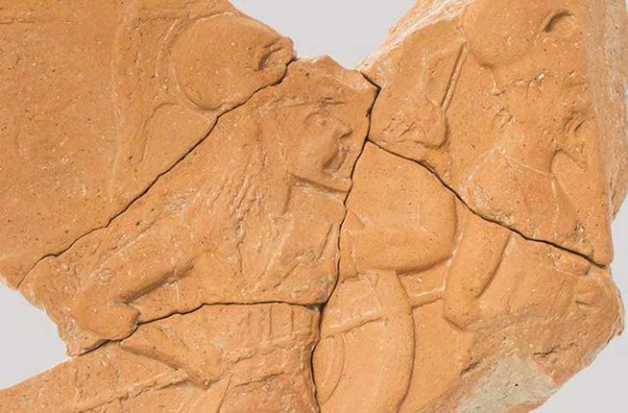 The 2,500-year-old terracotta relief discovered on St. Cyricus depicts marching hoplites. Source: National Institute and Museum of Archaeology