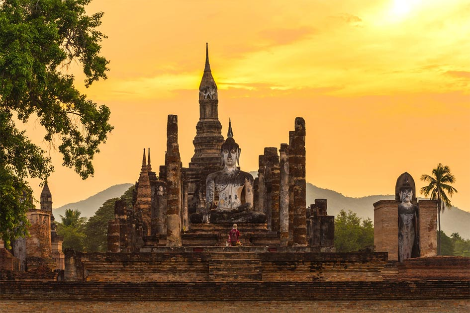 Ancient pagoda and big buddha at Sukhothai Historical Park, the birthplace of the Sukhothai Kingdom. Source: somrakjendee / Adobe Stock.