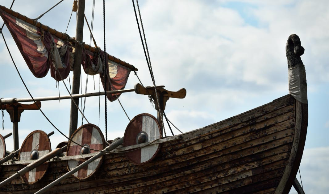 Close up of a longboat, similar to the Sutton Hoo ship. Source: Alex Stemmer / Adobe Stock.