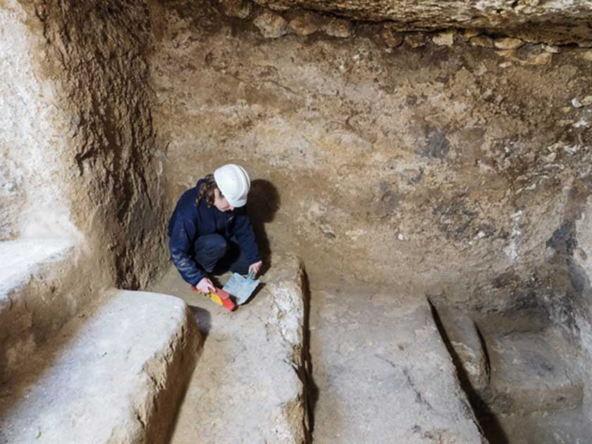 An archaeologist collects material in an underground chamber that may have been a hideout for rebels during the Bar Kokhba Revolt of the 2nd century AD.