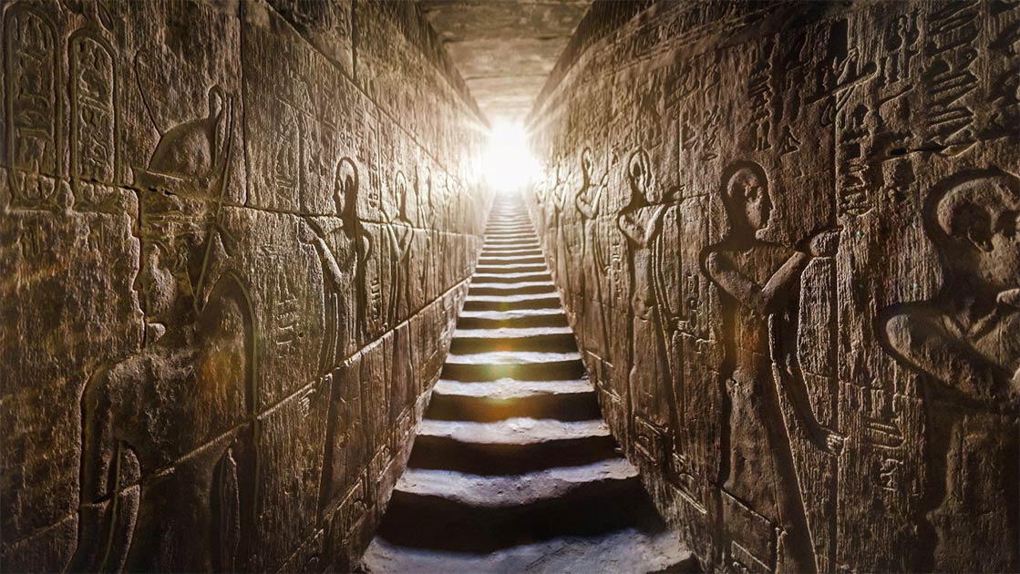 Temple of Edfu passage with glowing walls of Egyptian hieroglyphs on either side.	Source: Konstantin / AdobeStock