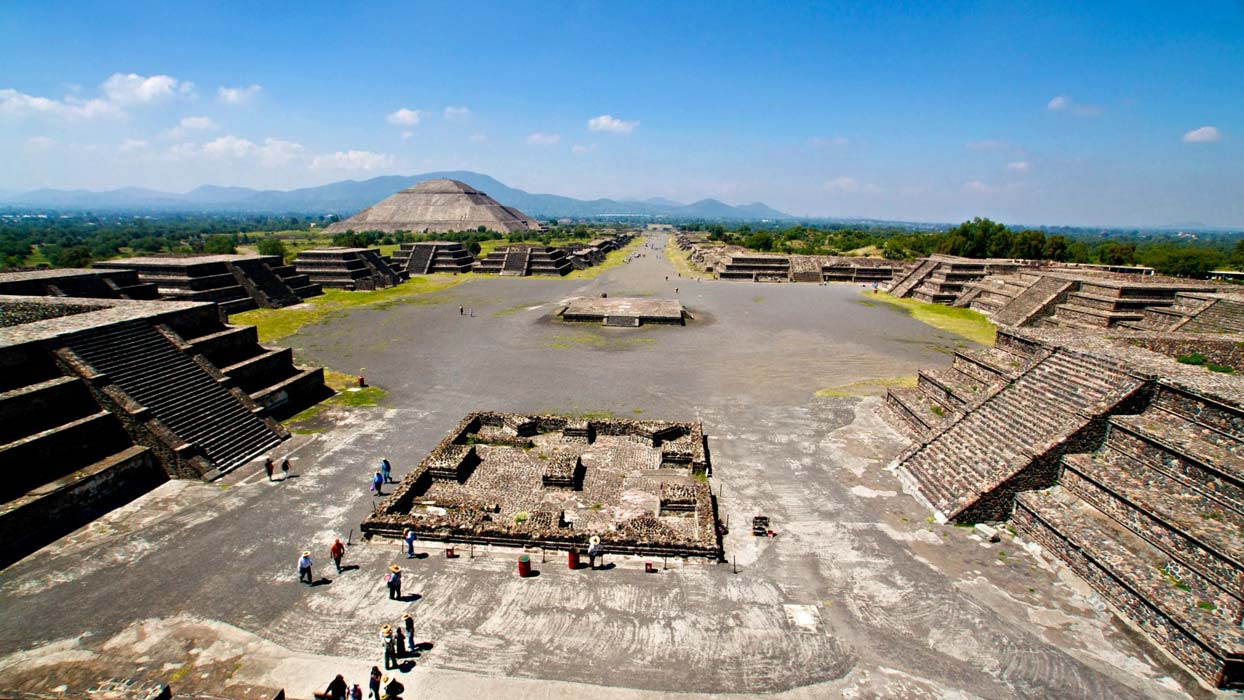 Aztec Avenue of the Dead stretches out before pyramids and shops of Mexico.