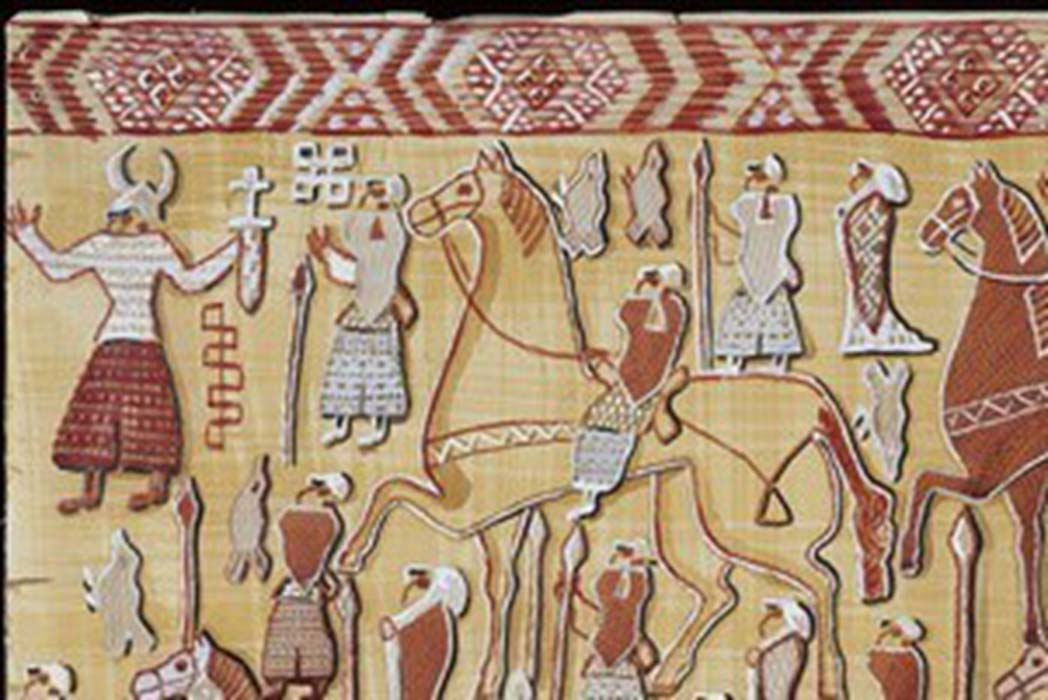 Section of tapestry discovered in the Oseberg ship burial mound showing a figure wearing a horned helmet.