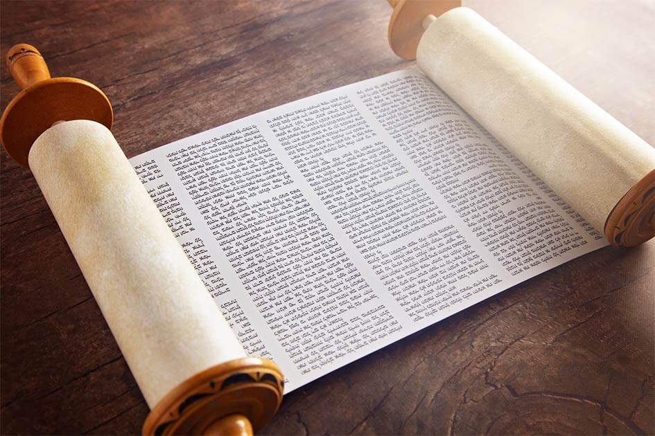 The Sefer Torah, or Toral scroll, is a handwritten copy of the Torah Pentateuch, used for ritual Torah readings, known as parashah. Source: pamela_d_mcadams / Adobe Stock
